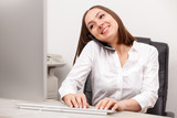 Businesswoman is phoning at her desk