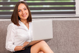 Smiling businesswoman is working from home