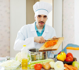 caucasian chef  works with vegetables