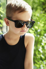 young handsome boy in sunglasses.Outdoor fashion child