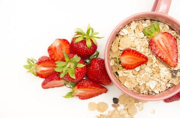Bowl of muesli, strawberries for healthy breakfast