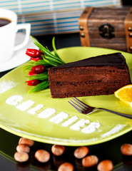 dark chocolate cake with word calories written on the plate