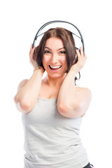 brunette with headphones listening to music on a white backgroun