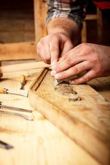 Carpenter restoring old furniture