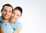 Portrait of smiling couple with blank copyspace