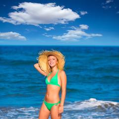 blond tourist girl in a tropical summer beach