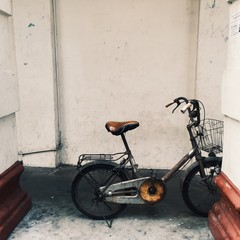 Old vintage bicycle parking beside the streer