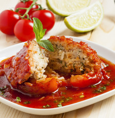 Bell peppers stuffed with meat, rice  and sauce on plate, select