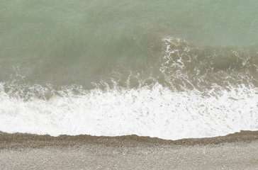 Wave on the beach - Stock Image.