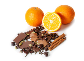 Chocolate, orange, spices isolated on white. Selective focus
