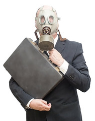 Businessman with gas mask and carrying a briefcase