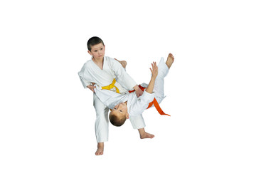 On a white background sportsmens trains judo throws