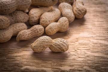big pile peanuts on wooden board food and drink concept