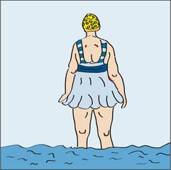 Frau mit Badekappe im Wasser