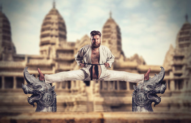 Karate fighter does the splits