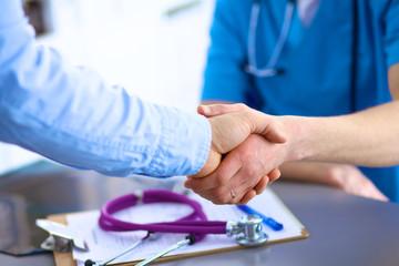 Handshake between doctor and a patient in the office