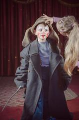 Girl Adjusting Hat of Boy Dressed as Clown