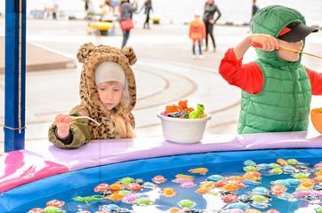 Children Playing at Fishing Pond Game at Fun Fair