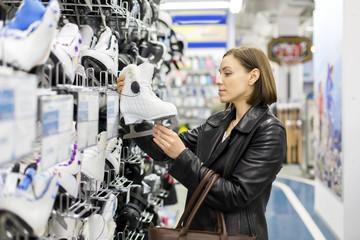 woman buys skates