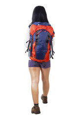 Backpacker walking in studio