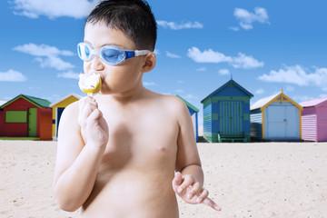 Boy enjoying a tasty ice cream at shore
