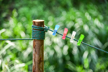 colorful of Clothespin clamp on rope