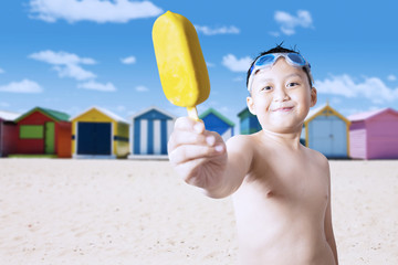Friendly child offering ice cream