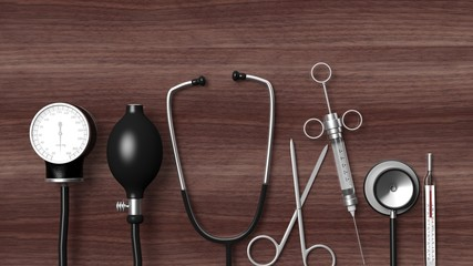 Various medical equipment on wooden background