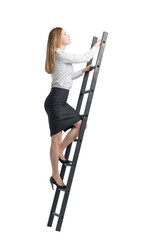 blonde young woman is climbing up