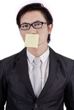 Man with post it on his mouth