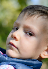 Close Up of Serious Young Boy Outdoors
