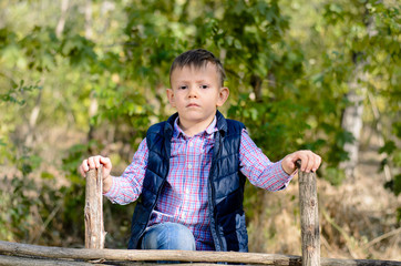 Serious Young Boy Outdoors