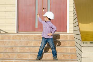 Boy Wearing Hard Hat on Steps Looking Back