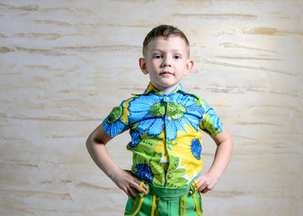 Boy Wearing Floral Print Shirt with Hands on Hips