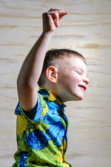 Young Boy Dancing and Snapping Fingers