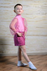 Boy Wearing Pink Dance Outfit Posing with Hand Up