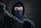 Murderer holding chain