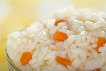 Bowl full of rice and carrots