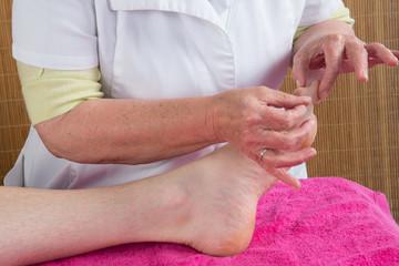 Woman therapist tries ti prick needle