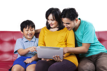 Portrait of happy family using tablet