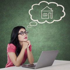 Pretty woman dreaming a new house