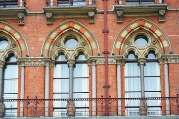 Close up view of red victorian windows