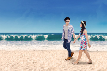 Two couple holding hands at seashore