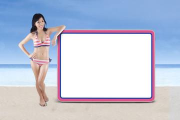 Woman wearing striped bikini with copyspace