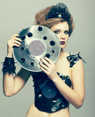Woman in dress of molten vinyl disk