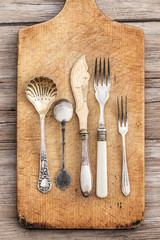 Old and vintage cutlery in a wooden table