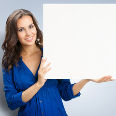 Young happy smiling woman with blank signboard
