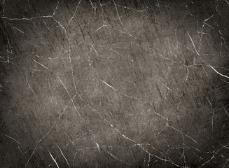 Scratched monochrome texture as abstract background.