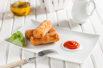 Chicken croquettes with cheese on a white background