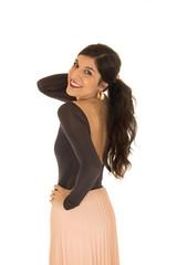 Pretty brunette female pulling her hair up posing smiling